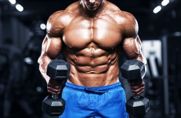 mh-muscular-man-working-out-in-gym-strong-male-torso-royalty-free-image-924491214-1557166711